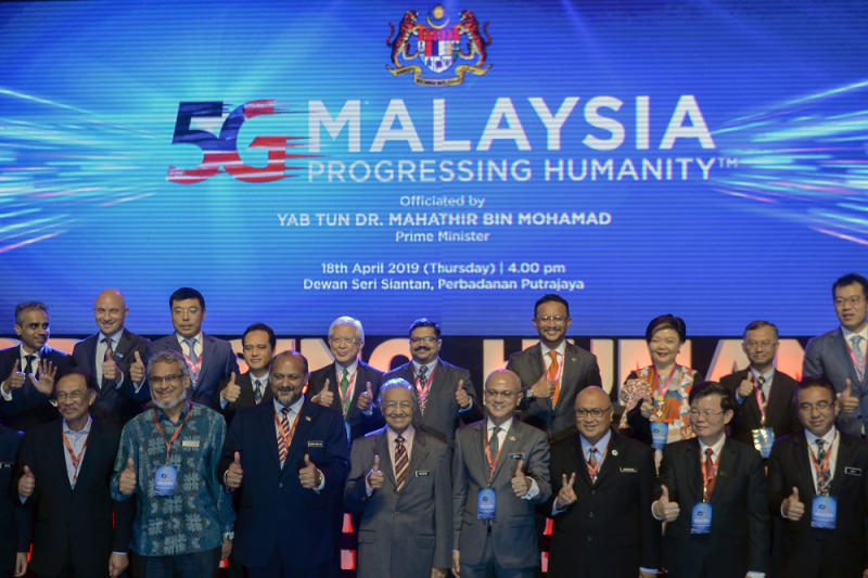 Prime Minister Tun Dr Mahathir Mohamad and Communication and Multimedia Minister Gobind Singh Deo pose for a group photo during the launch of the 5G Showcase in Putrajaya April 18, 2019. — Pictures by Mukhriz Hazim