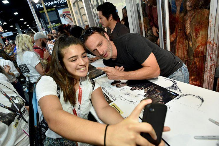 "SAN DIEGO, CA - JULY 10: Actor Andrew Lincoln (R) poses for a fan selfie to promote AMC's ""The Walking Dead"" at Comic-Con 2015 on July 10, 2015 in San Diego, California. (Photo by John Shearer/Getty Images for AMC)"
