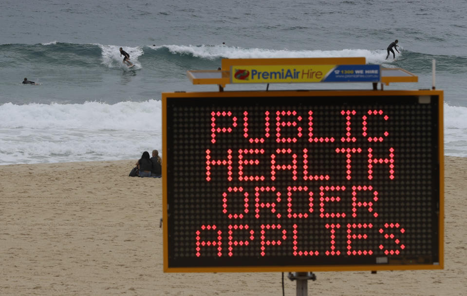 A temporary sign at a beach which reads: 'Public health order applies'.