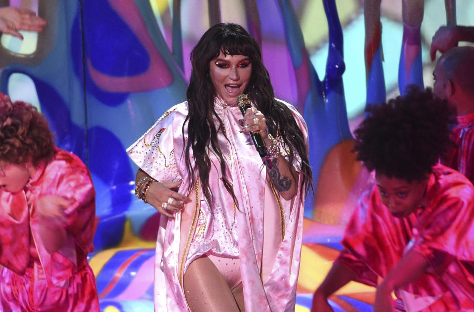 "In this Nov. 24, 2019 file photo, Kesha performs at the American Music Awards at the Microsoft Theater in Los Angeles. Kesha made a false claim that Dr. Luke raped Katy Perry when there's ""no evidence whatsoever"" that he did, a judge ruled this week while sending a long-running clash between Kesha and her former mentor toward trial. Kesha's lawyers said in a statement that they plan to appeal Thursday's ruling, which also says she owes the prominent producer over $373,000 in interest on royalties she paid him years late. (Photo by Chris Pizzello/Invision/AP, File)"