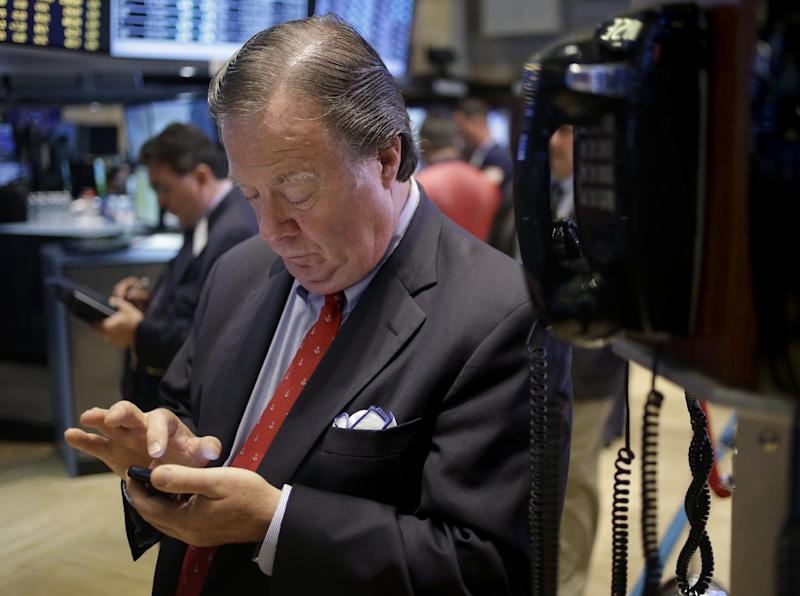 FILE - In this Tuesday, Sept. 3, 2013, file photo, traders work on the floor at the New York Stock Exchange in New York. World stocks drifted on Friday Sept. 27, 2013, with markets in China edging slightly higher as investors stayed cautious ahead of a major holiday and details from the highly anticipated unveiling of a free trade zone in Shanghai. (AP Photo/Seth Wenig, File)