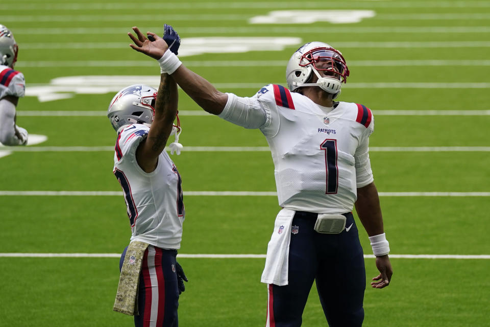 New England Patriots quarterback Cam Newton (1) and receiver Damiere Byrd (10) celebrate a touchdown against the Houston Texans during the second half of an NFL football game, Sunday, Nov. 22, 2020, in Houston. (AP Photo/David J. Phillip)