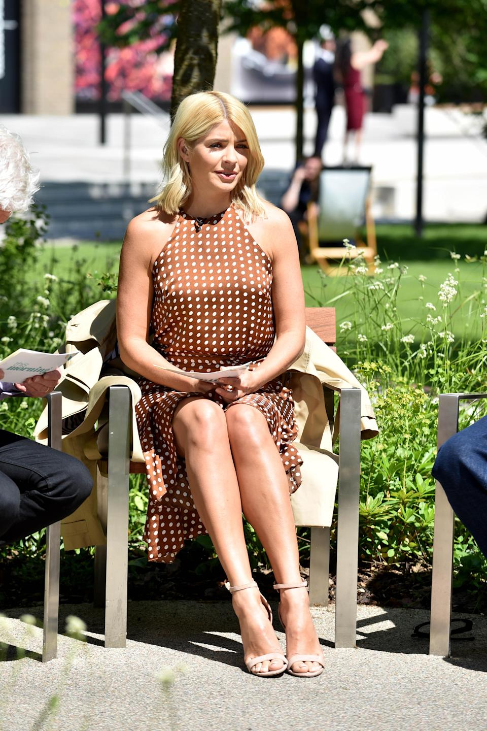 <p>Holly Willoughby looked relaxed and summery whilst filming outside the ITV studios in London, wearing a polka dot dress from Topshop. <em>[Photo: Getty]</em> </p>
