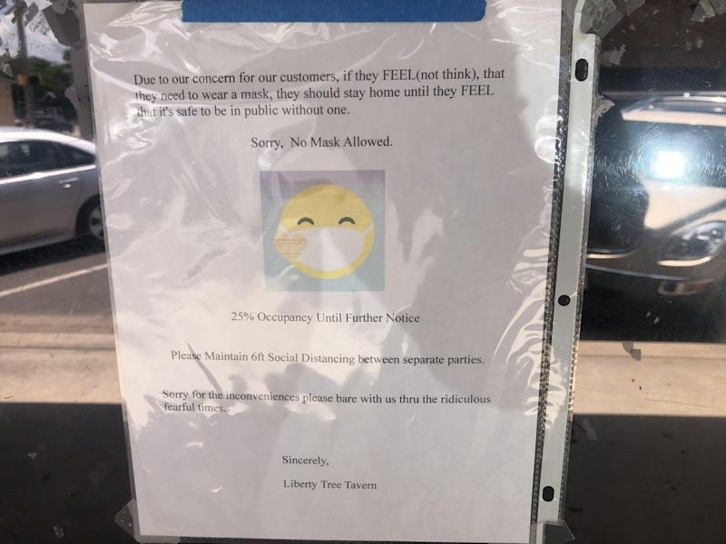 The Liberty Tree Tavern in downtown Elgin has posted a sign outside its entrance cautioning that anyone wearing a mask will not be allowed in.