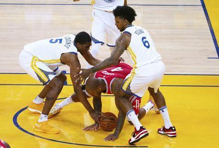 May 20, 2018; Oakland, CA, USA; Houston Rockets forward P.J. Tucker (4) battles for possession below Golden State Warriors forward Kevon Looney (5) and guard Nick Young (6) the third quarter of game three of the Western conference finals of the 2018 NBA Playoffs at Oracle Arena. Mandatory Credit: Kelley L Cox-USA TODAY Sports