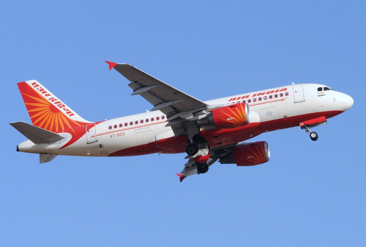 An Air India domestic flight takes off from Sardar Vallabhbhai International Airport in Ahmedabad on May 12, 2012.  National carrier Air India fired 25 more striking pilots and cancelled 16 domestic flights, as a pilot walkout entered its fifth day. Pilots are protesting against former Indian Airlines pilots, who moved to Air India when the two state-run companies merged in 2007, being trained for new Boeing 787 Dreamliner airplanes. Some 200 pilots who worked for Air India, which was the international carrier, before it was merged with domestic carrier Indian Airlines are on strike. AFP PHOTO / Sam PANTHAKY