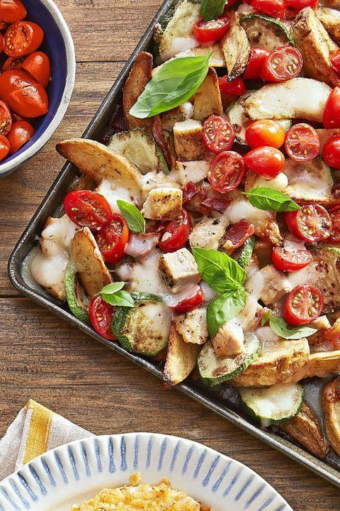 """<p>This Italian twist on nachos is also the perfect Christmas appetizer, with festive red tomatoes and green basil. </p><p><strong><a href=""""https://www.countryliving.com/food-drinks/recipes/a44281/italian-potato-wedge-nachos-recipe/"""" rel=""""nofollow noopener"""" target=""""_blank"""" data-ylk=""""slk:Get the recipe"""" class=""""link rapid-noclick-resp"""">Get the recipe</a>.</strong></p>"""