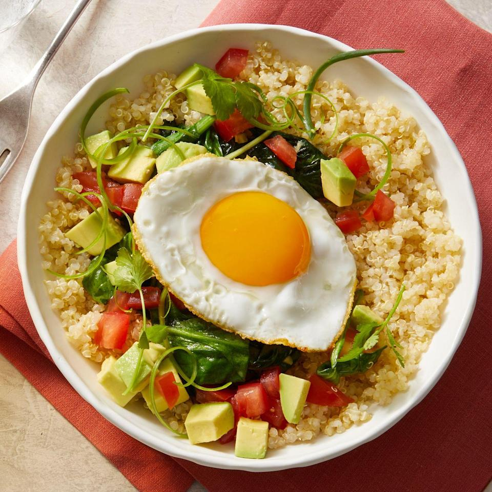 """<p>For a light breakfast that's still filling, throw together avocado, tomato, leftover grains, and a fried egg. This recipe is also dairy-free, in case you happen to be cutting back.</p><p><em><strong><a href=""""https://www.prevention.com/food-nutrition/recipes/a34079505/grain-bowl-with-sauteed-spinach-recipe/"""" rel=""""nofollow noopener"""" target=""""_blank"""" data-ylk=""""slk:Get the recipe from Prevention »"""" class=""""link rapid-noclick-resp"""">Get the recipe from Prevention »</a></strong></em></p>"""