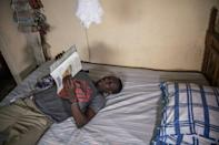 Kervens Casseus, 20, studies at his aunt's house in Port-au-Prince, fearful of even going out onto the street