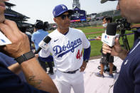 National League manager Dave Roberts, of the Los Angeles Dodgers, talks with the media during warms-ups for the MLB All-Star baseball game, Monday, July 12, 2021, in Denver. (AP Photo/David Zalubowski)