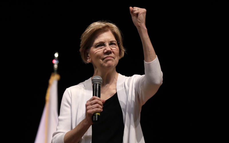 "FILE - In this Aug. 8, 2018 file photo, U.S. Sen. Elizabeth Warren, D-Mass., gestures during a town hall style gathering in Woburn, Mass. She took the DNA test President Donald Trump urged. She's hitting back in personal terms, calling him ""creepy"" on Twitter, in real time. And she's not backing down. When it comes to challenging the man who redefined the rules of American political combat, Warren in some ways is doing it Trump's way. She's getting some backlash from Native Americans and grumbling from Democrats who'd rather be talking about toppling Congress' Republican majorities in the midterm elections three weeks away. (AP Photo/Charles Krupa, File )"