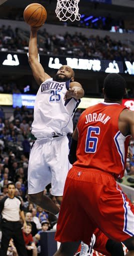 Dallas Mavericks shooting guard Vince Carter (25) scores against Los Angeles Clippers center DeAndre Jordan (6) during the first half of an NBA basketball game in Dallas, Monday, Feb. 13, 2012. (AP Photo/LM Otero)