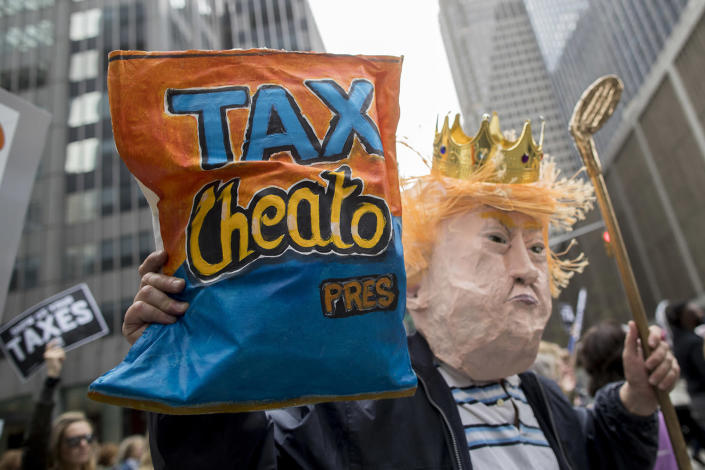 <p>Demonstrators participate in a march calling on President Donald Trump to release his tax returns, Saturday, April 15, 2017, in New York. (Photo: Mary Altaffer/AP) </p>