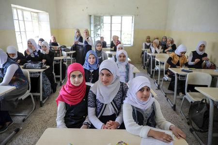 Pupils attend a class at an elementary school in eastern Mosul