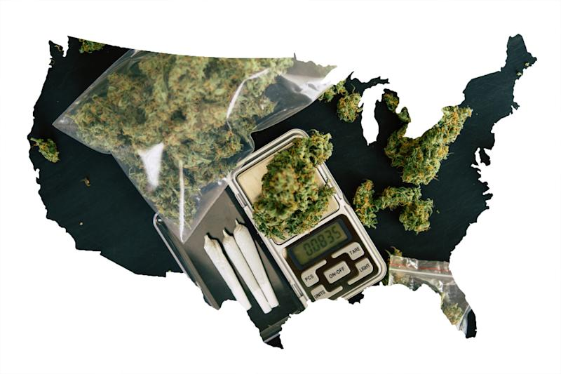 A black silhouette of the United States, partially filled in by baggies filled with dried cannabis, three pre-rolled joints, and a scale.