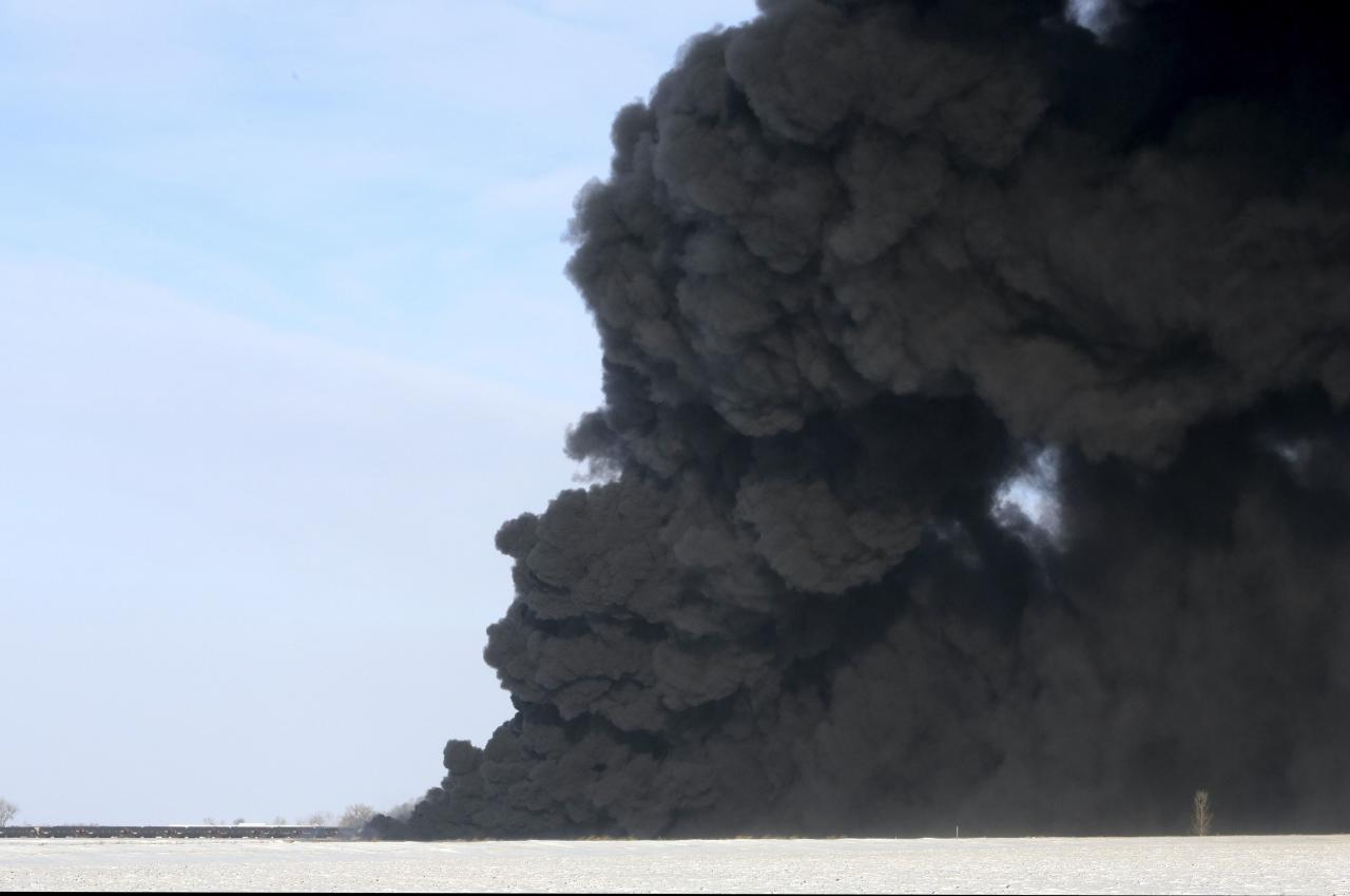 A plume of smoke rises from scene of a derailed train near Casselton, North Dakota December 30, 2013. The train that derailed was travelling eastbound, carrying crude oil, according to a BNSF spokeswoman. Emergency and fire-fighting crews are responding to the derailment, which occurred around 2:10 p.m. Casselton is roughly 20 miles (32 kms) west of Fargo, North Dakota along Interstate 94. REUTERS/Michael Vosburg/Forum News Service (UNITED STATES - Tags: DISASTER ENERGY TRANSPORT) NO SALES. NO ARCHIVES. FOR EDITORIAL USE ONLY. NOT FOR SALE FOR MARKETING OR ADVERTISING CAMPAIGNS