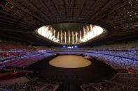 <p>TOKYO, JAPAN - JULY 23: General view inside the stadium as fireworks are seen during the Opening Ceremony of the Tokyo 2020 Olympic Games at Olympic Stadium on July 23, 2021 in Tokyo, Japan. (Photo by Ezra Shaw/Getty Images)</p>