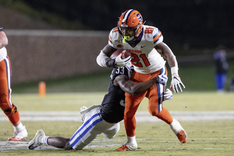 Syracuse's Moe Neal (21) carries the ball as Duke's Leonard Johnson (33) attempts a tackle during the second half of an NCAA college football game in Durham, N.C., Saturday, Nov. 16, 2019. (AP Photo/Ben McKeown)