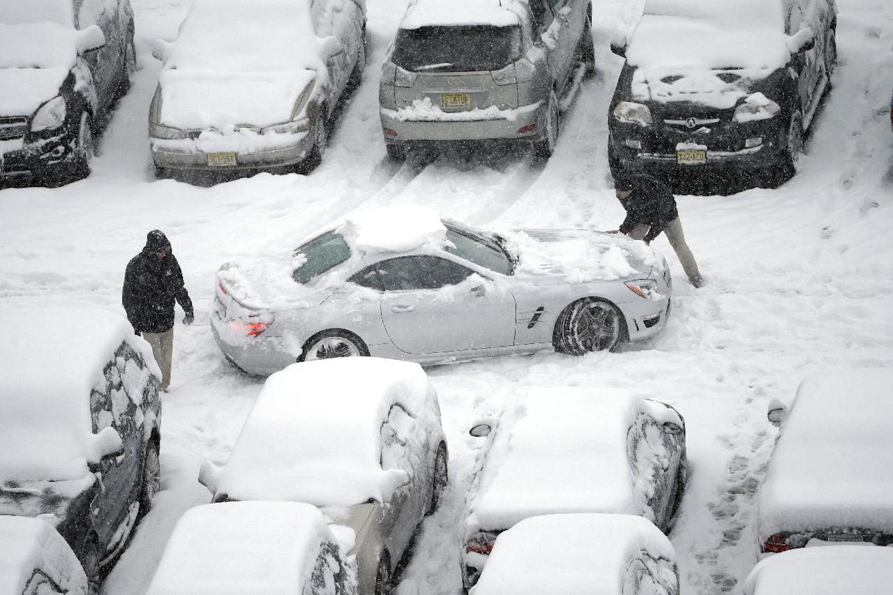 Snow-covered cars occupy a parking lot at Lincoln Financial Field during the second half of an NFL football game between the Philadelphia Eagles and the Detroit Lions, Sunday, Dec. 8, 2013, in Philadelphia. (AP Photo/Matt Rourke)