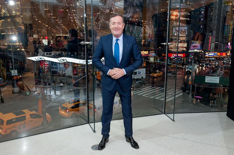 NEW YORK, NY - DECEMBER 09: Piers Morgan visits 'Extra' at their New York studios at H&M in Times Square on December 9, 2014 in New York City. (Photo by D Dipasupil/Getty Images for Extra)