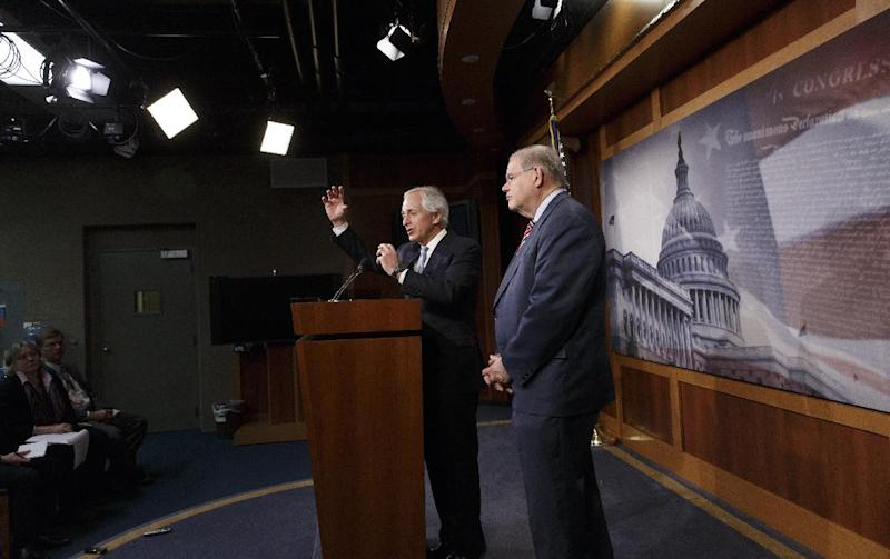 Senate Foreign Relations Committee Chairman Sen. Robert Menendez, D-N.J., right, and the committee's ranking member, Sen. Bob Corker, R-Tenn., participate in a news conference on Capitol Hill in Washington, Thursday, March 27, 2014, just after the Senate passed the Ukraine Aid Bill in a show of support for the people of Ukraine and a get-tough message for Russian President Vladimir Putin for taking over the Crimea region. (AP Photo/J. Scott Applewhite)