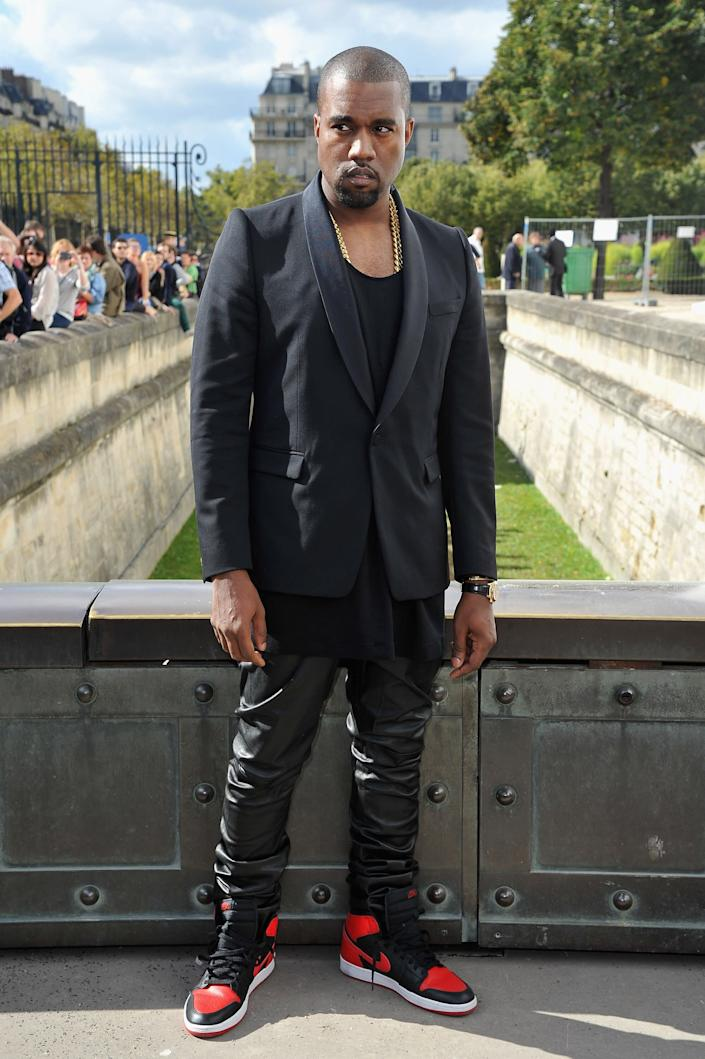 PARIS, FRANCE - SEPTEMBER 28: Kanye West arrives at the Christian Dior Spring / Summer 2013 show as part of Paris Fashion Week on September 28, 2012 in Paris, France. (Photo by Pascal Le Segretain/Getty Images)