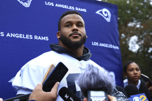 LA Rams Aaron Donald takes part in the press conference during the NFL training session at the Grove Hotel in Chandler's Cross, Watford, England, Friday, Oct. 25, 2019. The LA Rams are preparing for an NFL regular season game against the Cincinnati Bengals in London on Sunday. (AP Photo/Leila Coker)