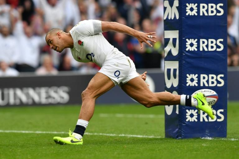 England's centre Jonathan Joseph scores a try during their Six Nations rugby union match against Scotland, at Twickenham stadium in south-west London, on March 11, 2017