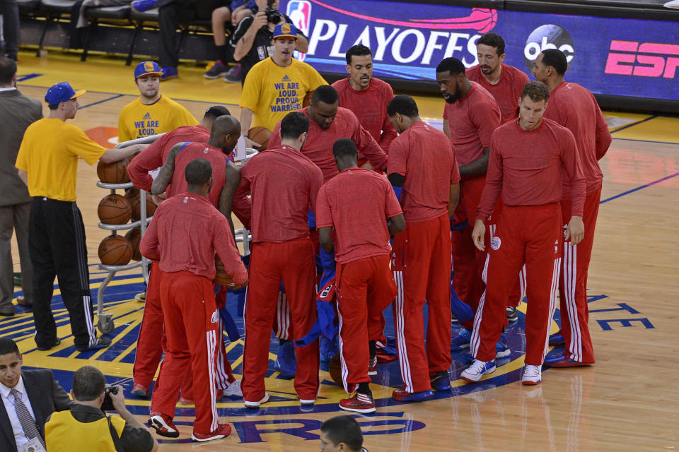 Clippers players removed their warmup jackets in a sign of protest over the alleged racist remarks made by team owner Donald Sterling in 2014. (Jose Carlos Fajardo/Bay Area News Group via Getty Images)