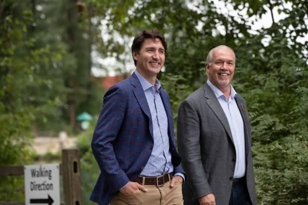 Prime Minister Justin Trudeau, left, and B.C. Premier John Horgan arrive for an announcement and news conference at Lafarge Lake Park, in Coquitlam, B.C., on Thursday. (Darryl Dyck/The Canadian Press - image credit)