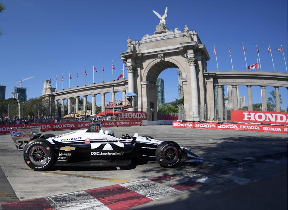 Simon Pagenaud drives into turn one past the Princes Gates during the 2019 Honda Indy Toronto.