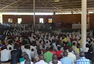 People attend a mass on September 10, 2014 at The Shrine of Mont Sion Gikungu in Bujumbura in memory of three Italian nuns who were raped and murdered in twin attacks in their convent (AFP Photo/Esdras Ndikumana)
