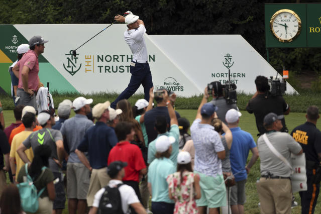 Bryson DeChambeau, top center, hits his tee shot on the 18th hole during the final round of the Northern Trust golf tournament, Sunday, Aug. 26, 2018, in Paramus, N.J. DeChambeau won the tournament. (AP Photo/Mel Evans)