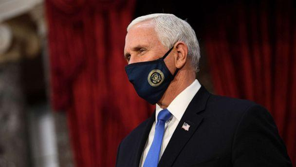 PHOTO: Vice President Mike Pence wears a face mask as he waits to participate in mock swearing-in ceremonies for Senators in the Old Senate Chambers at the U.S. Capitol Building, Jan. 3, 2021, in Washington. (Kevin Dietsch/Pool via Getty Images)