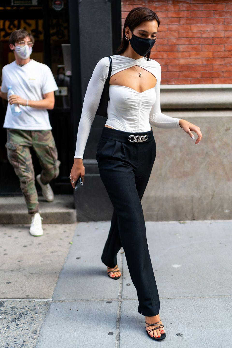 <p><strong>16 July </strong>Dua Lipa was spotted in New York in tailored trousers, chic strappy sandals and a corset-style top. </p>