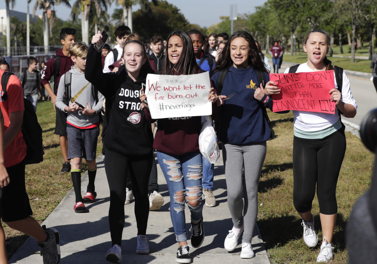Students from Westglades Middle School in Parkland, Fla., walk out as part of a nationwide protest against gun violence on Wednesday. (Lynne Sladky/AP)