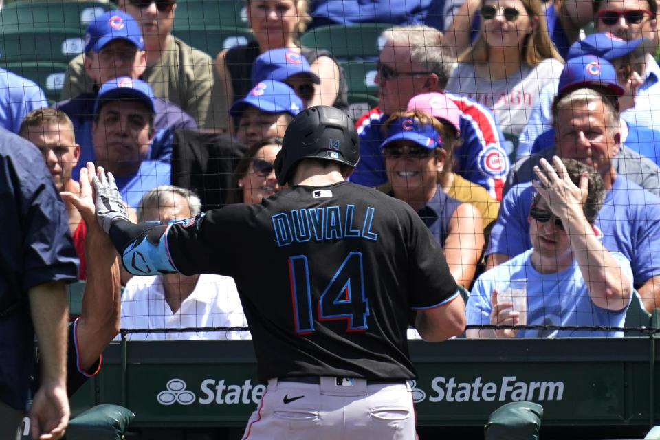 Miami Marlins manager Don Mattingly, left, congratulates Adam Duvall after his two-run home run during the third inning of a baseball game against the Chicago Cubs in Chicago, Saturday, June 19, 2021. (AP Photo/Nam Y. Huh)