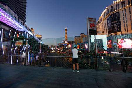 A tourist takes a picture above the Las Vegas Strip in Las Vegas, Nevada, U.S., August 27, 2018. Picture taken August 27, 2018.  REUTERS/Mike Blake