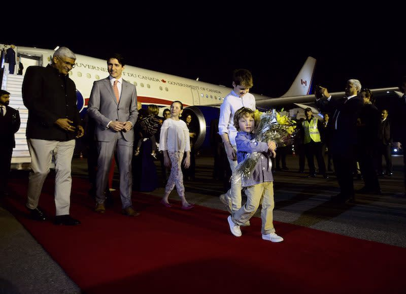 <p>Hadrien Trudeau was spotted carrying a bouquet of flowers after the prime minister's family embarked on a 20-hour journey that included a refuelling stop in Rome. Photo from The Canadian Press. </p>