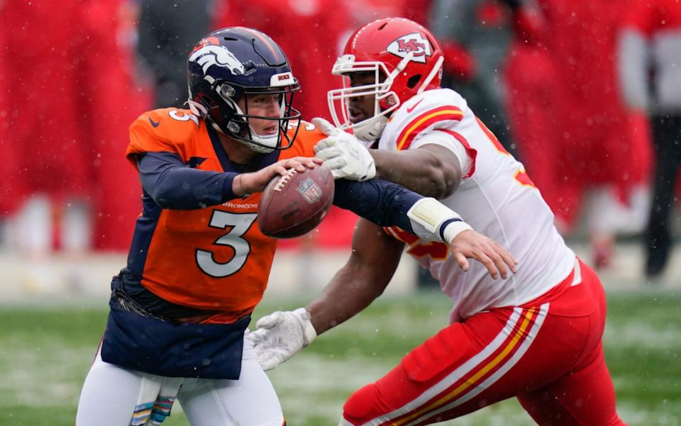 Denver Broncos quarterback Drew Lock scrambles under pressure from Kansas City Chiefs defensive tackle Chris Jones during the first half of an NFL football game Sunday, Oct. 25, 2020, in Denver. - AP