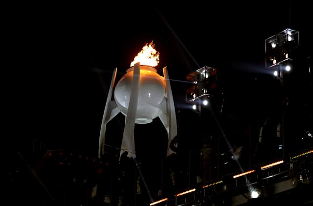 The Olympic torch burns.