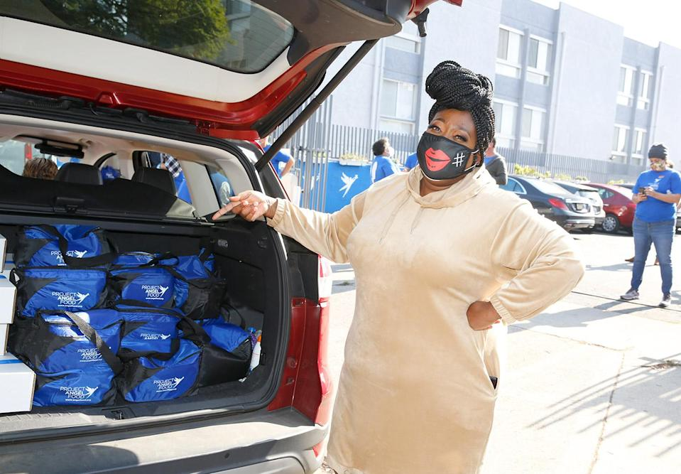 <p><em>The Real</em>'s Loni Love volunteers at Project Angel Food in Los Angeles to deliver 1,900 meals to critically-ill people in L.A. on Thursday.</p>