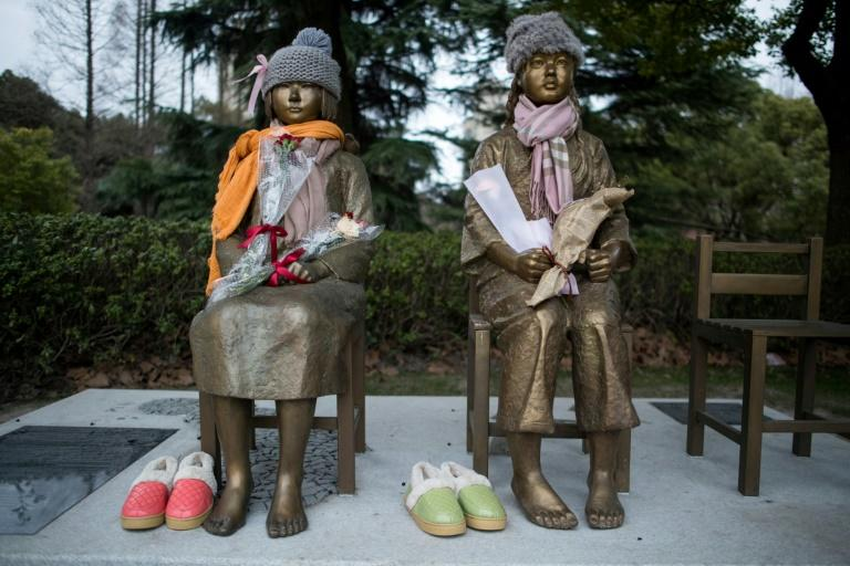 Two statues symbolising so-called 'comfort women' are seen in a park in Shanghai