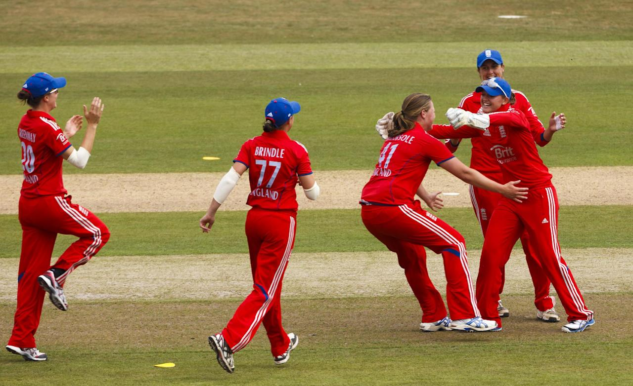 England's Anya Shrubsole (no hat) celebrates the wicket of Australian opener Meg Lanning during the One Day International at The County Ground, Hove.
