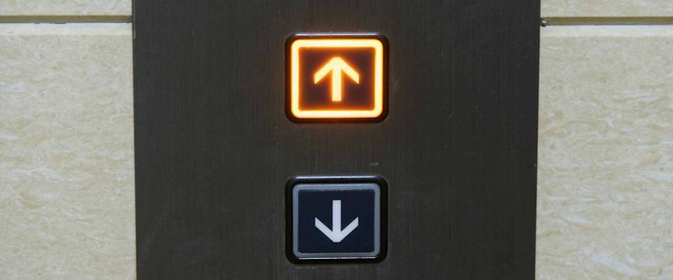 Up and down elevator buttons with up-button lighten up
