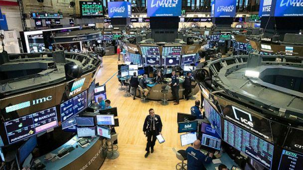 PHOTO: A trader walks on the floor of the New York Stock Exchange during President Donald Trump's televised speech from the White House, in New York, March 13, 2020. (Mark Lennihan/AP, FILE)