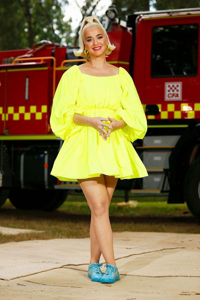 <p>The pregnant star wore a neon yellow mini dress by Maison Valentino for the charity concert.</p>