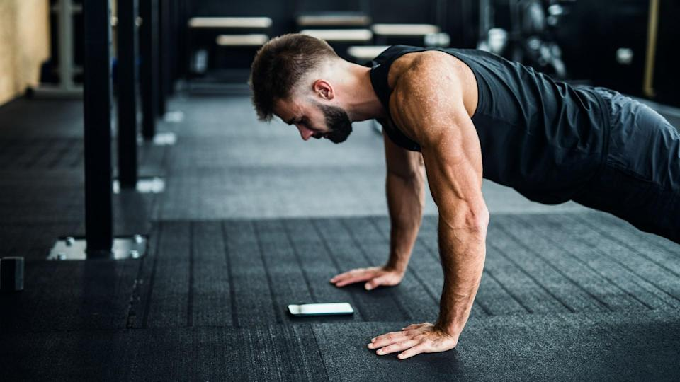 Man using phone in a gym.