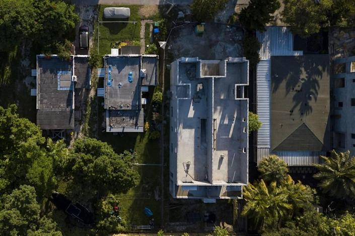 An aerial view of properties located in the 3100 block of Ohio Street in the West Grove shows how the new houses are built to occupy a much larger footprint than the old ones.