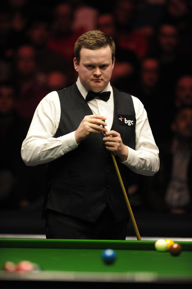 Shaun Murphy of England gestures during his match against John Higgins of Scotland during the semi-final match in the BGC Masters snooker tournament at Alexandra Palace in north London on January 21, 2012. AFP PHOTO / CARL COURT (Photo credit should read CARL COURT/AFP/Getty Images)